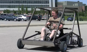 William Marshall, a 2012 graduate from the University of Kansas School of Engineering, drives a parallel hybrid go-kart he helped design as part of his work with the KU EcoHawks.