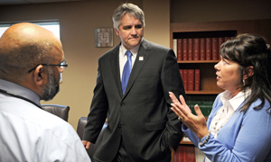 Dr. Roy Jensen, director of The University of Kansas Cancer Center, visits in Salina with oncologist Peeran Sandhu and Lynn Marshall, R.N, patient navigator. (Photo by Tom Dorsey, Salina Journal)