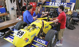 Robert Sorem with students and Jayhawk Motorsports car