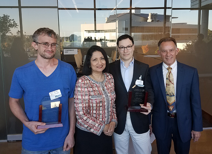 2016 Baxendale Innovation Award recipients Associate Professor Laird Forrest, far left, and KU Med Director of Dermatology Daniel Aires, MD, JD, center right, receive their award from Provost and Executive Vice Chancellor Neeli Bendapudi and Jim Baxendale, former director of technology transfer at the University of Kansas.