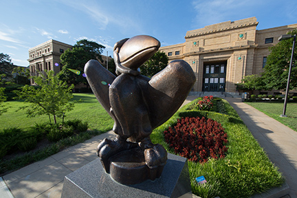 The bronze Jayhawk statue in front of Strong Hall, KU's central administration building.