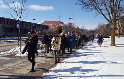 A second line brass band led marchers across campus during the 2018 Martin Luther King Jr. celebration at KU.